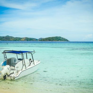 Malcapuya Island With Speed Boat